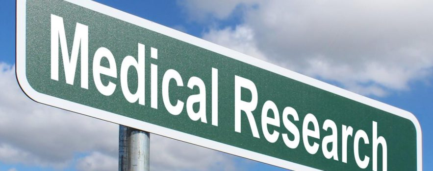 road sign saying medical research