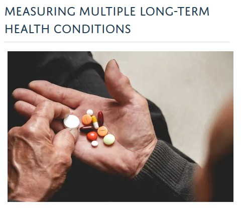 Photo of a hand holding several large medicine pills